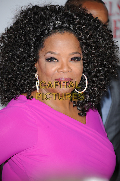 Oprah Winfrey<br /> &quot;Lee Daniels' The Butler&quot; Los Angeles Premiere held at Regal Cinemas L.A. Live, Los Angeles, California, USA.        <br /> August 12th, 2013    <br /> headshot portrait pink hoop earrings <br /> CAP/DVS<br /> &copy;DVS/Capital Pictures