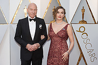 Sir Patrick Stewart and Sunny Ozell arrive on the red carpet of The 90th Oscars&reg; at the Dolby&reg; Theatre in Hollywood, CA on Sunday, March 4, 2018.<br /> *Editorial Use Only*<br /> CAP/PLF/AMPAS<br /> Supplied by Capital Pictures