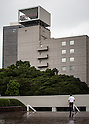 September 7, 2015, Tokyo, Japan - A business man walks near the Toshiba Corporation headquarters in downtown Tokyo. The accounting scandal hit electronics maker logged a 37.8 billion yen net loss for FY 2014 as probe discovers a 155 bilion yen padding. (Photo by AFLO)