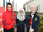 Tadhg Forde Dunne, Jack McDonnell and Callum Byrne Members of Boyne A.C. who took part in the Christmas Run at Lourdes Stadium in aid of Our Lady of Lourdes Hospital. Photo:Colin Bell/pressphotos.ie