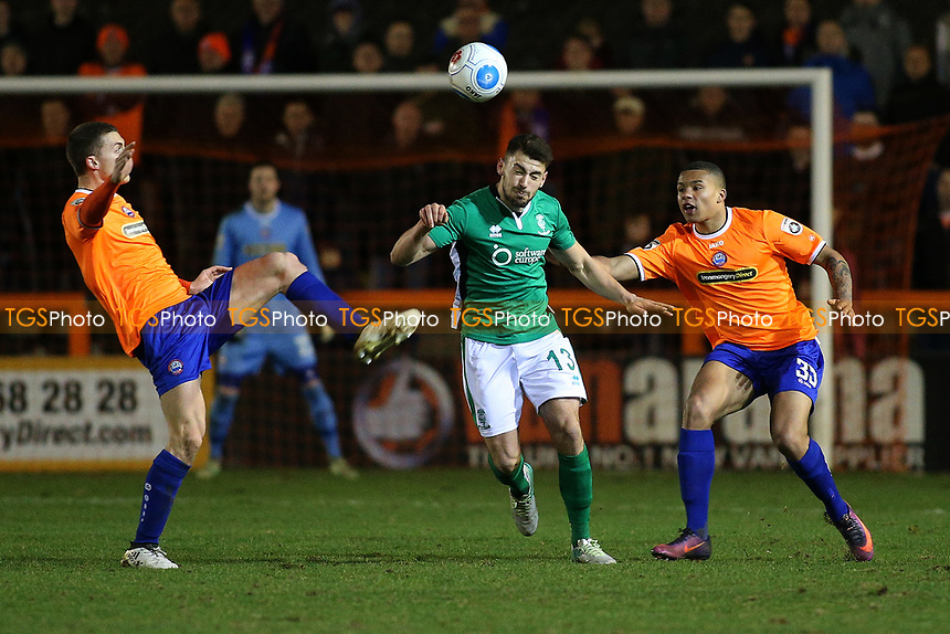 Johnny Margetts of Lincoln City tangles with Harry Lee (L) and Frankie Musonda of Braintree Town during Braintree Town vs Lincoln City, Vanarama National League Football at the IronmongeryDirect Stadium on 7th March 2017