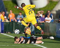Emilio Renteria of the Crew leaps over Bobby Convey of Earthquakes after Convey tackled the ball away from him during the first half of the game at Buck Shaw Stadium in Santa Clara, California.  San Jose Earthquakes tied Columbus Crew, 2-2.