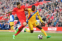 Liverpool's Roberto Firmino vies for possession with Crystal Palace's Jeffrey Schlupp<br /> <br /> Photographer Terry Donnelly/CameraSport<br /> <br /> The Premier League - Liverpool v Crystal Palace - Sunday 23rd April 2017 - Anfield - Liverpool<br /> <br /> World Copyright &copy; 2017 CameraSport. All rights reserved. 43 Linden Ave. Countesthorpe. Leicester. England. LE8 5PG - Tel: +44 (0) 116 277 4147 - admin@camerasport.com - www.camerasport.com