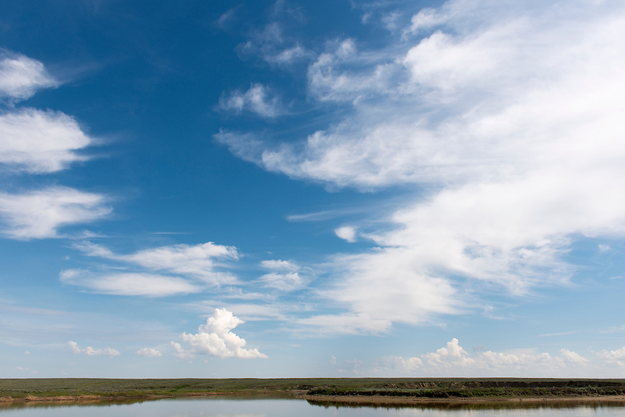Clouds rise above the American Prairie Reserve south of Malta, Montana.