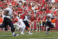 NWA Democrat-Gazette/ANDY SHUPE<br /> University of Texas at El Paso's Autrey Golden (right) carries the ball into the end zone Saturday, Sept. 5, 2015, during the second quarter of play in Razorback Stadium in Fayetteville. Visit nwadg.com/photos to see more from the game.