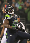 Seattle Seahawks defensive end Cliff Avril (56) celebrates after sacking Carolina Panthers quarterback Kam Chancellor (1) in the NFC Western Division Playoffs at CenturyLink Field  on January 10, 2015 in Seattle, Washington. The Seahawks beat the Panthers 31-17. ©2015. Jim Bryant Photo. All Rights Reserved.