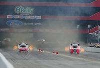 Jun. 19, 2011; Bristol, TN, USA: NHRA funny car driver Cruz Pedregon (right) races alongside Bob Tasca III during eliminations at the Thunder Valley Nationals at Bristol Dragway. Mandatory Credit: Mark J. Rebilas-