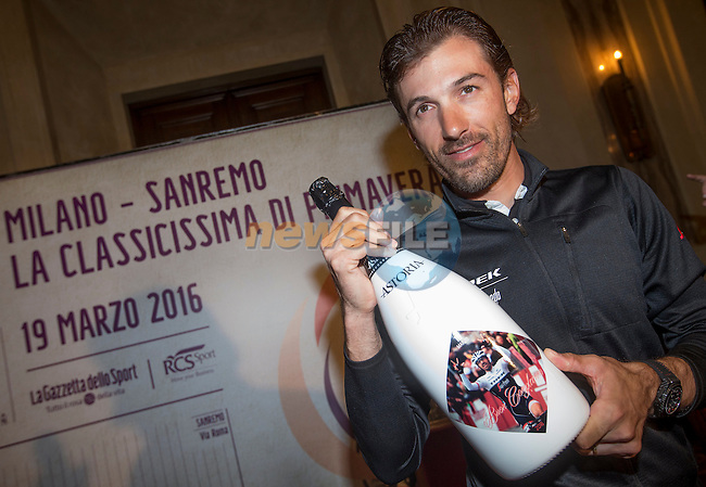 Birthday boy Fabian Cancellara (SUI) Trek-Segafredo presented with a special bottle of Astoria at the end of the press conference for the Milano-San Remo cycling race at Palazzo Marino in Milan, 18 March 2016.<br /> Picture: ANSA/CLAUDIO PERI | Newsfile<br /> <br /> <br /> All photos usage must carry mandatory copyright credit (© Newsfile | Claudio Peri)