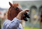 June 8, 2019 : A man in a horse mask smokes a cigar on Belmont Stakes Festival Saturday at Belmont Park in Elmont, New York. Scott Serio/Eclipse Sportswire/CSM