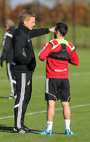 Pictured L-R: Garry Monk and Leon Britton Wednesday 05 November 2014<br />