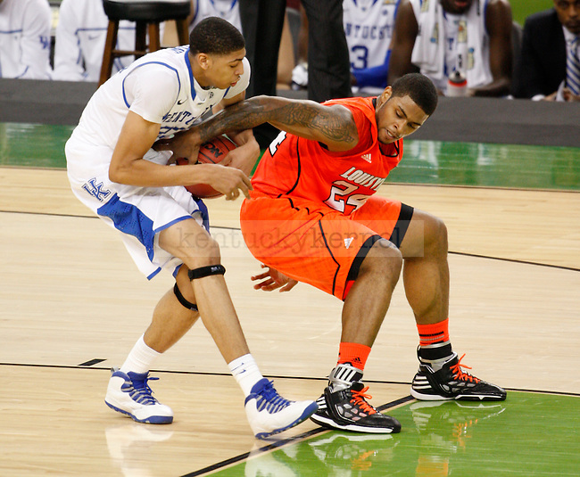 Kentucky Wildcats forward Anthony Davis and Louisville Cardinals forward Chane Behanan fight for possession of the ball during the first half of the UK vs. Louisville National Semi-finals at the Super Dome in New Orleans, Louisiana  March 31, 2012.. Photo by Brandon Goodwin | Staff
