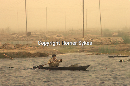 The Mesopotamian or Iraq Marshes near Basra a destroyed Marsh Arab village. Iran-Iraq Iran Iraq war also known as First Persian Gulf War and by the British at the time as the Gulf War. Lasted from 1980 to 1988. Marsh Arab soldier.