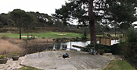 BNPS.co.uk (01202 558833)<br /> Pic:  BNPS<br /> <br /> The view from a neighbours garden after the trees were felled.<br /> <br /> A prestigious golf club that axed 34 protected trees has been ordered to plant new specimens in their place to compensate for the act of 'environmental vandalism'. <br /> <br /> Officials at Parkstone Golf Club in Poole, Dorset, must grow 13 'advanced' specimens of at least 10ft in height in the same spot the mature pine trees once stood.<br /> <br /> The club, that counts Harry Redknapp as a member, fell foul of a 56-year-old Tree Preservation Order (TPO) covering the 70ft tall trees when it cut them down in December 2018.<br /> <br /> The owners of £1m homes that back on to the course were furious as they said the trees provided shelter from the wind and privacy from golfers playing the 1st and 2nd holes.