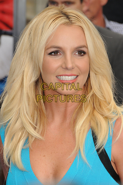 Britney Spears<br /> &quot;Smurfs 2&quot; Los Angeles Premiere held at the Regency Village Theatre, Westwood, California, USA.<br /> July 28th, 2013<br /> headshot portrait blue turquoise <br /> CAP/ADM/BP<br /> &copy;Byron Purvis/AdMedia/Capital Pictures