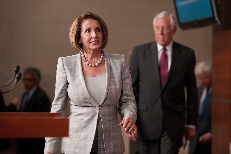 UNITED STATES - SEPTEMBER 06:  House Minority Leader Nancy Pelosi, D-Calif., and Minority Whip Steny Hoyer, D-Md., arrive to a news conference in the Capitol Visitor Center on job creation. (Photo By Tom Williams/Roll Call)