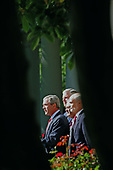 President George W. Bush delivers his weekly radio address in the Rose Garden on September 3,2005. Left to right: Chairman of the Joint Chiefs of Staff Richard Myers, Secretary of Defense Donald Rumsfeld, and Secretary of the Department of Homeland Security Michael Chertoff. <br /> Credit: Dennis Brack - Pool via CNP