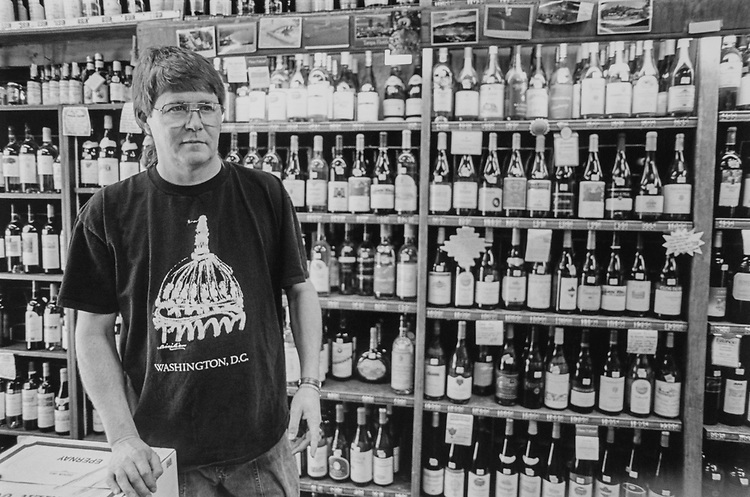 Gary Hortch manager Hayden's Liquor store 7th N.C. SE., on April 7, 1994. (Photo by CQ Roll Call via Getty Images)