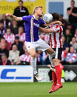 Exeter City's Jayden Stockley vies for possession with Lincoln City's Neal Eardley<br /> <br /> Photographer Chris Vaughan/CameraSport<br /> <br /> The EFL Sky Bet League Two Play Off First Leg - Lincoln City v Exeter City - Saturday 12th May 2018 - Sincil Bank - Lincoln<br /> <br /> World Copyright &copy; 2018 CameraSport. All rights reserved. 43 Linden Ave. Countesthorpe. Leicester. England. LE8 5PG - Tel: +44 (0) 116 277 4147 - admin@camerasport.com - www.camerasport.com