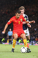 Daniel Georgievski being pressured by Paul Dixon in the Scotland v Macedonia FIFA World Cup Qualifying match at Hampden Park, Glasgow on 11.9.12.