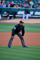 1B umpire Edwin Moscoso handles the calls on the bases during the game between the Salt Lake Bees and the Tacoma Rainiers at Smith's Ballpark on May 27, 2019 in Salt Lake City, Utah. The Bees defeated the Rainiers 5-0. (Stephen Smith/Four Seam Images)