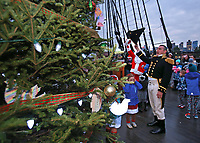 "(12/03/2017- Boston, MA) At the flick of the switch, Commander Nathaniel R. Shick, right, rejoices at a Christmas Tree lighting ceremony held aboard ""Old Ironsides,"" the USS Constitution at the Charlestown Navy Yard on Sunday, December 3, 2017. Staff Photo by Matt West"