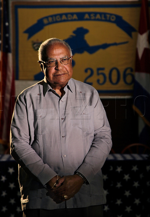 "Luis Gonzalez Lalondry, author of the book Bahia de Cochinos, photographed at the Bay of Pigs Museum in Little Havana.  He is a member of the Bay of Pigs Veterans Association, Brigade 2506...""Me and another brigadista have the distinction of being the only ones  captured along with a Cuban soldier we had taken prisoner. We ended up spending the next five days sharing our water, a can of condensed milk and  spaghettii with him. We ended up treating him like he was one of us. His name was Manuel del Rio and later when we were in prison in Cuba he sent me a message inside that he was no longer a miliciano. That was a victory for me."""