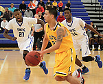 Southwestern Illinois College hosted the Jefferson Community and Technical College in an afternoon game on Saturday at the home of the Blue Storm. SWIC players Kyle Lemons (21, left) and Romondo Ray (34, right) close in on Jefferson's Alan Almanza (20) as the double-team him as he dribbles and then tries to shoot.