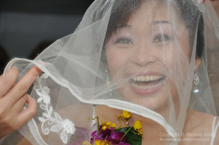 Taiwanese Wedding -- The happy bride, ready to embark on a life together with her husband.