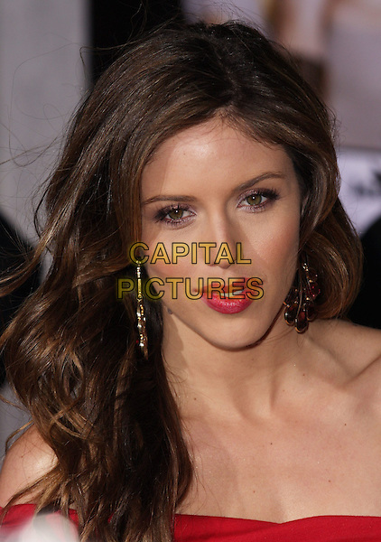 "KAYLA EWELL .""When In Rome"" Los Angeles Premiere - Arrivals held at The El Capitan Theater, Hollywood, CA, USA, .27th January 2010..portrait headshot red strapless lipstick make-up dangly earrings .CAP/ADM/CH.©Charles Harris/AdMedia/Capital Pictures"