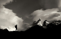 Paine Massif mountains and hiker. Torres Del Paine National Park, Chile, Patagonia