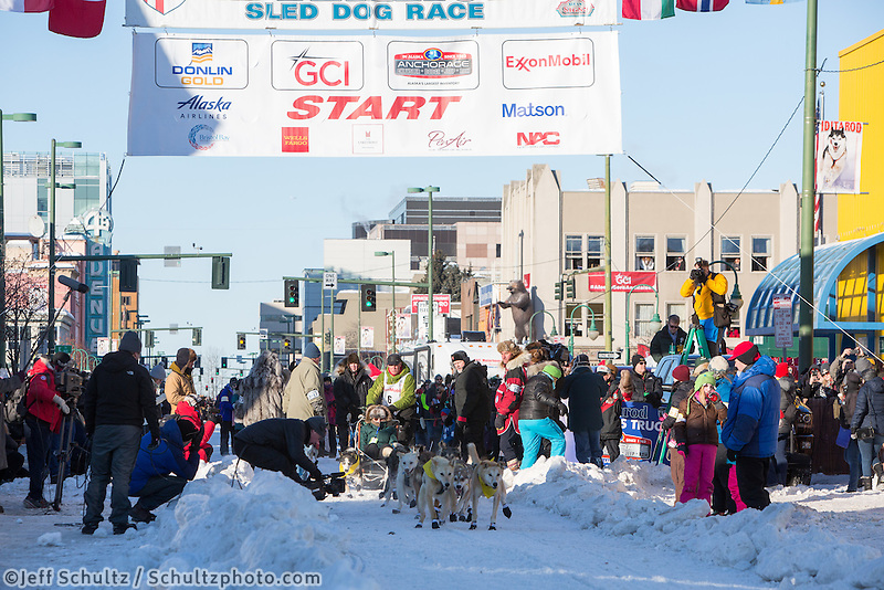 Linwood Fiedler and team leave the ceremonial start line with an Iditarider and handler at 4th Avenue and D street in downtown Anchorage, Alaska on Saturday March 4th during the 2017 Iditarod race. Photo © 2017 by Brendan Smith/SchultzPhoto.com.