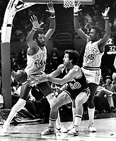 Warriors Clifford Ray and Purvis Short guarding Kansas City #20   Ernie Grundfeld. (1980 photo/Ron Riesterer)