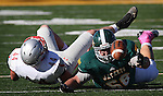 SPEARFISH, SD - OCTOBER 10, 2015 -- Cody Cole #68 of Black Hills State tries to recover a fumble past defender Carter Wasser #44 of Western State Colorado during their college football game Saturday at Lyle Hare Stadium in Spearfish, S.D. (Photo by Dick Carlson/Inertia)