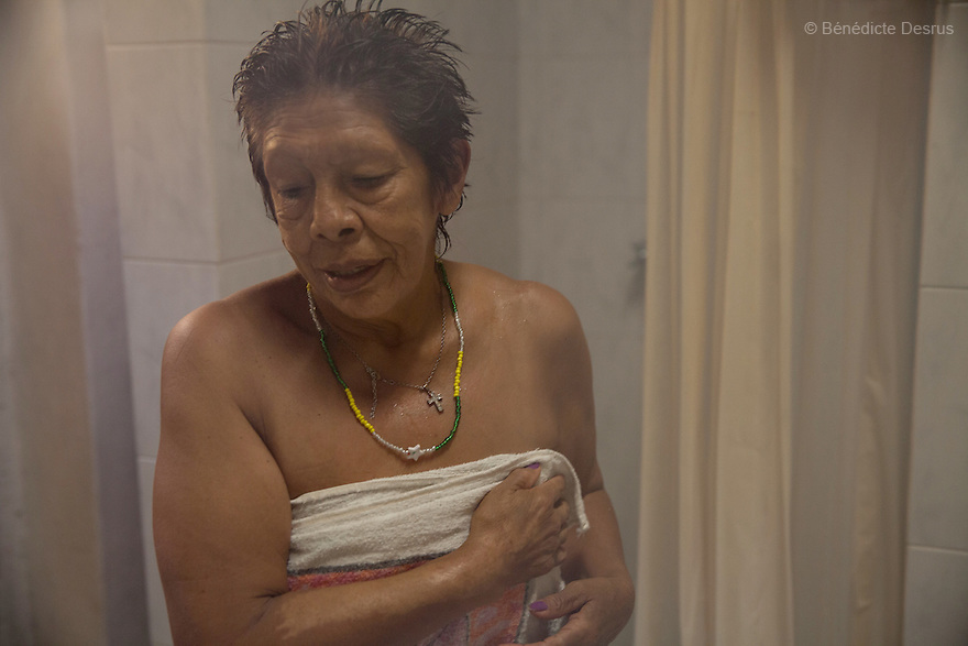 Luchita, a resident of Casa Xochiquetzal, takes a shower at the shelter in Mexico City, Mexico on September 3, 2013. Casa Xochiquetzal is a shelter for elderly sex workers in Mexico City. It gives the women refuge, food, health services, a space to learn about their human rights and courses to help them rediscover their self-confidence and deal with traumatic aspects of their lives. Casa Xochiquetzal provides a space to age with dignity for a group of vulnerable women who are often invisible to society at large. It is the only such shelter existing in Latin America. Photo by Bénédicte Desrus