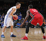 SIOUX FALLS, SD - MARCH 5:  Max Landis #10 of Fort Wayne looks to pass against defender Kason Harrell #32 of South Dakota in 2016 Summit League Tournament play. (Photo by Dick Carlson/Inertia)