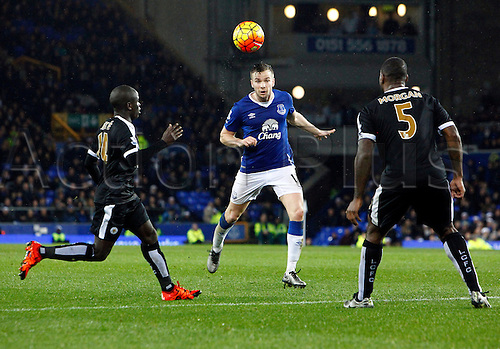 19.12.2015. Goodison Park, Liverpool, England. Barclays Premier League. Everton versus Leicester City. Everton midfielder Tom Cleverley heads a through ball past Leicester City's midfielder Ngolo Kanté and skipper Wes Morgan