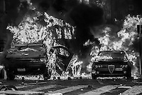 A car and a riot police truck are set on fire  by the rioters  after the Senate and Lower House vote of confidence that resulted in a razor-thin victory for Berlusconi to continue his mandate. Rome, Italy. 14 Dec. 2010
