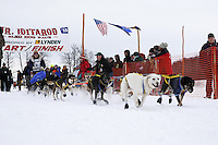 Jonathon Biggerstaff and dog team leaves the start line of the 2013 Junior Iditarod on Knik Lake.  Knik Alaska..Photo by Jeff Schultz/IditarodPhotos.com   Reproduction prohibited without written permission
