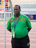 Jamaica head coach Wendell Downswell stands on the sidelines before the third place game of the CONCACAF Men's Under 17 Championship at Catherine Hall Stadium in Montego Bay, Jamaica. Panama defeated Jamaica, 1-0.