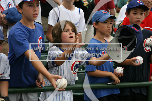 August 9, 2009:  Iowa Cubs fans get autographs after a game at Wrigley Field in Chicago, IL.  Iowa is the Pacific Coast League Triple-A affiliate of the Chicago Cubs.  Photo By Mike Janes/Four Seam Images