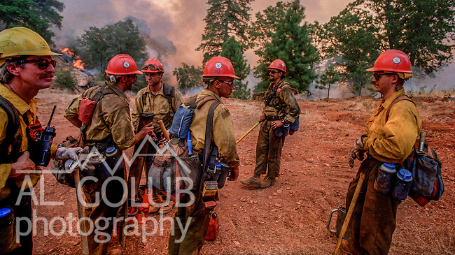 August 16, 1996 Sonora, California  -- Rogge Fire – Stanislaus Hotshots take a short break after finishing burning project.  The Ackerson and Rogge Fires combined to char 60,000 acres in 1996. The Rogge Fire was centered on the north side of the Tuolumne River, burning over Jawbone Ridge and Cherry Creek areas.