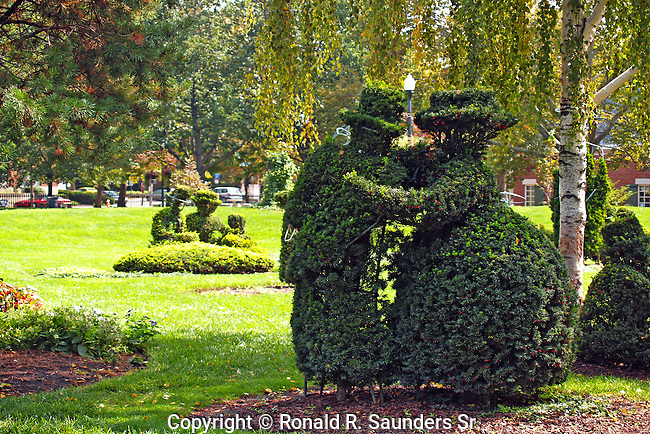 "A re-creation in sculpted shrubbery of French artist Georges Seurat's famous painting, ""A Sunday Afternoon on the Ile De La Grande Jatte.""<br />