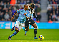 30th November 2019; St James Park, Newcastle, Tyne and Wear, England; English Premier League Football, Newcastle United versus Manchester City; Allan Saint-Maximin of Newcastle United tries to run past Fernandinho of Manchester City but Fernandinho beats him to the ball  - Strictly Editorial Use Only. No use with unauthorized audio, video, data, fixture lists, club/league logos or 'live' services. Online in-match use limited to 120 images, no video emulation. No use in betting, games or single club/league/player publications