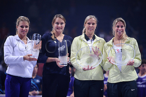 28.10.2012 Istanbul, Turkey. Mary Kirilenko RUS and Nadia Petrova RUS celebrate beating Andrea Hlavackova CZE and Lucie Hradecka CZE. Pitcured with the winners and runners up trophy.