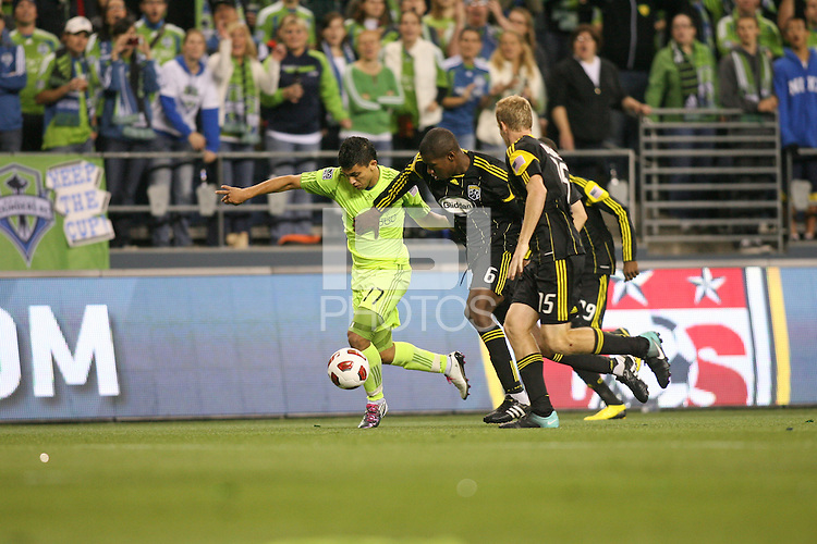 Fredy Montero (17)of the Seattle Sounders FC fights for the ball against Andy Iro (6) of the Columbus Crew. The Seattle Sounders FC defeated the Columbus Crew 2-1 during the US Open Cup Final at Qwest Field in Seattle,WA, on October 5, 2010.