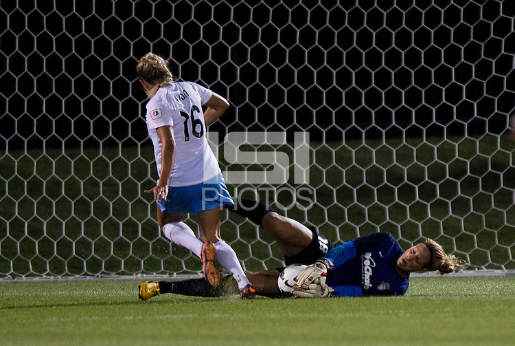 Chantel Jones (18) of the Washington Spirit makes a save on Adriana Leon (16) of the Chicago Red Stars during a game at the Maryland SoccerPlex in Boyds, MD.