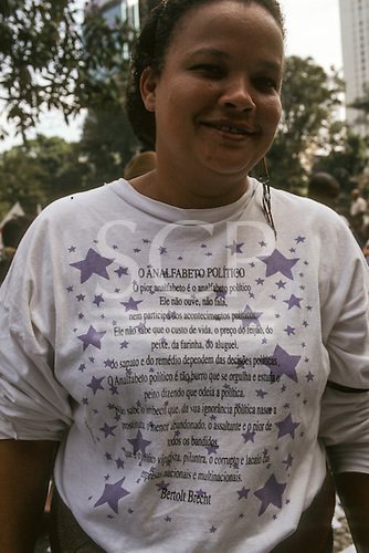 Acre State, Brazil. Rubber tapper woman with a peom about politics from Bertolt Brecht on her t-shirt.