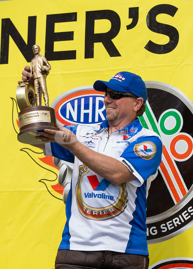 Jun. 2, 2013; Englishtown, NJ, USA: NHRA pro mod driver Mike Janis celebrates after winning the Summer Nationals at Raceway Park. Mandatory Credit: Mark J. Rebilas-
