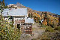 Located off Hwy 550 near the crest of Red Mountain Pass—this is the site of the National Bell Mine. During its booming years, there were as many as 10,000 inhabitants living in Red Mountain Town. In all of its glory, it had over 100 businesses, a post office, jail, schools, newspapers, saloons and gambling halls. Winters were extremely rough and only the most rugged individuals stayed. Several fires between 1892 and 1937 nearly leveled the town. However, regardless how difficult the environment, over thirty million dollars in gold, silver, lead, zinc and copper has been taken out of this area. You can overlook this town site from Hwy 550 at the Idarado Mine turnoff or park your car at the Red Mountain Pass area and hike into the town site.