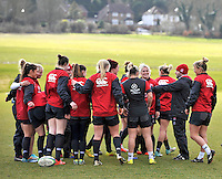 Guildford, England. Huddle of England Women Sevens in training for Sevens World Series in round three in Atlanta, USA. Surrey Sports Park on March 5, 2015 in Guildford, England.